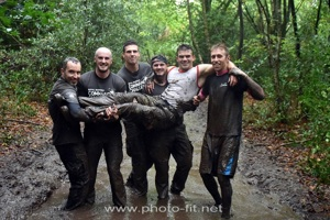 Commando Challenge team carrying one of their team mates