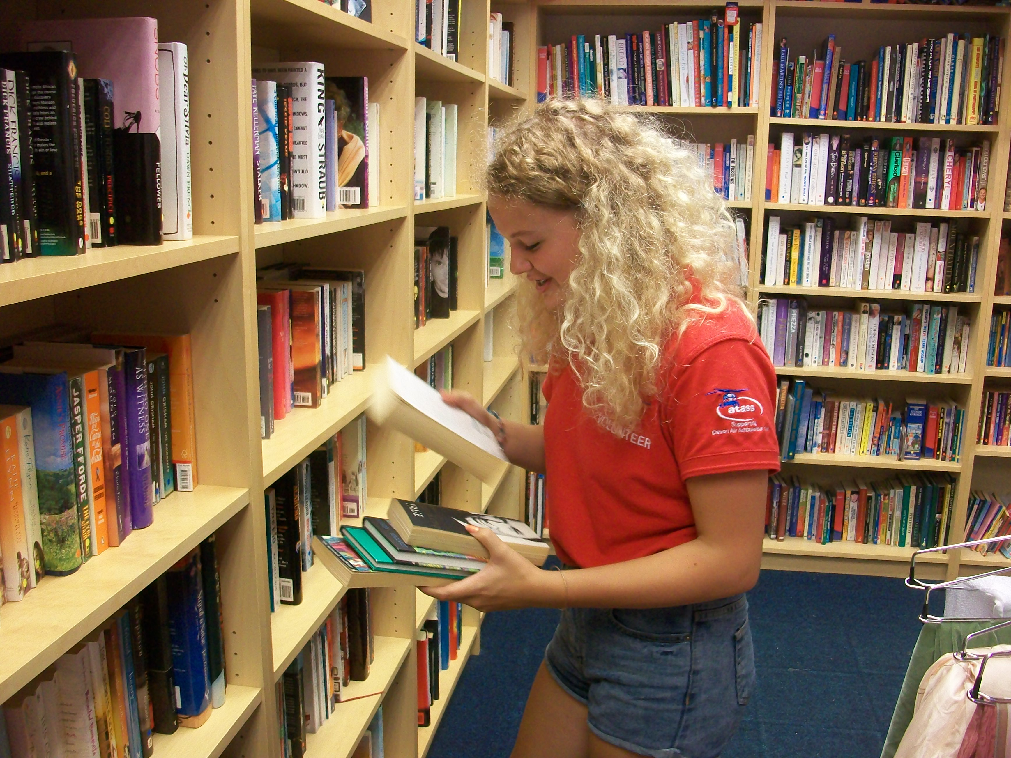 One of our young volunteers gains experience in one of our charity shops