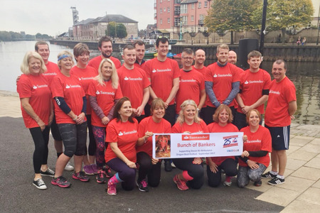 The Santander team at the 2017 Dragon Boat Festival with their cheque for Devon Air Ambulance