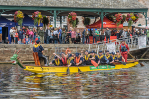 A 2019 Dragon Boat Festival team prepares to set off for their race on the River Exe
