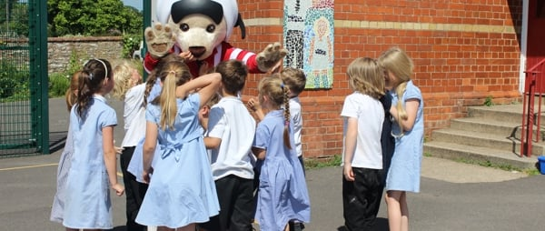Culmstock school children embrace Ambrose