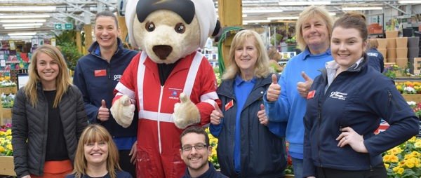 Staff supporters from Otter Nursery post with our Devon Air Ambulance mascot Ambrose