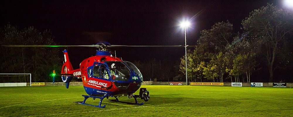 Helicopter lands on footfall field at night