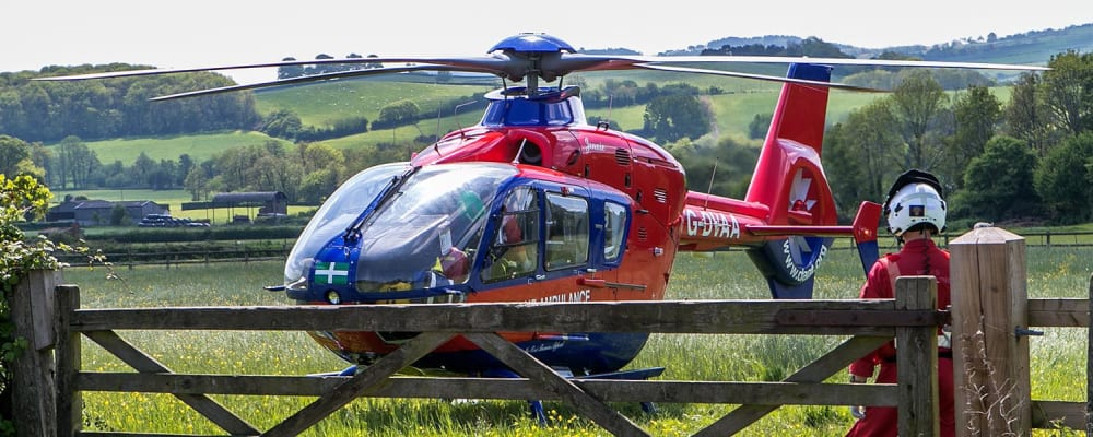 Credit to Kandid for this mission picture of one of our Devon Air Ambulances in a field with a member of the crew.