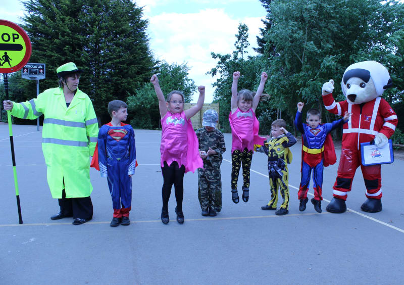 Pinhoe school children have fun with Ambrose and the local lollipop person