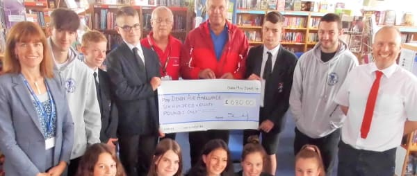 Teign School students present cheque to Devon Air Ambulance volunteer