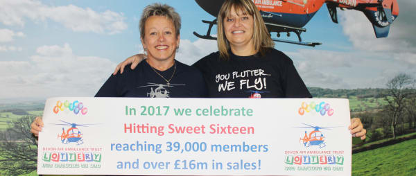 Our lottery team members, Tracy and Jane , celebrate 39,000 members