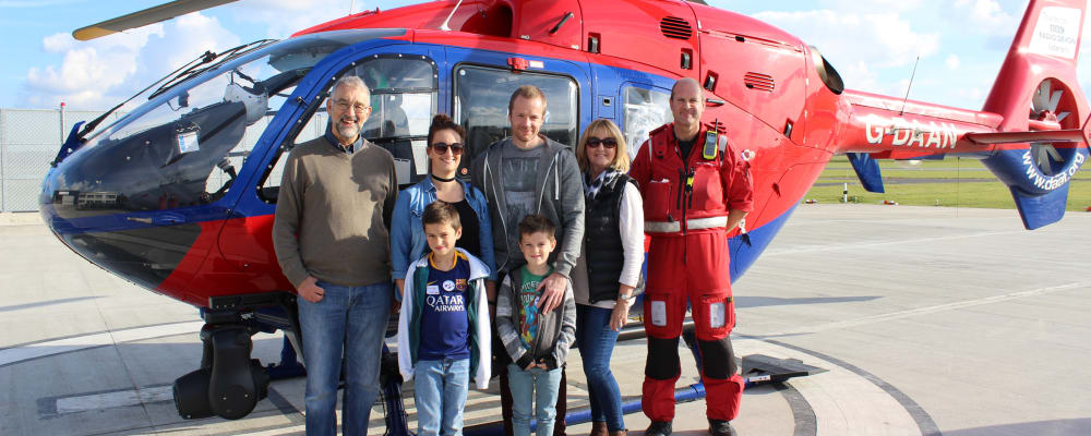 Finley Sheehan and his family with one of our aircraft