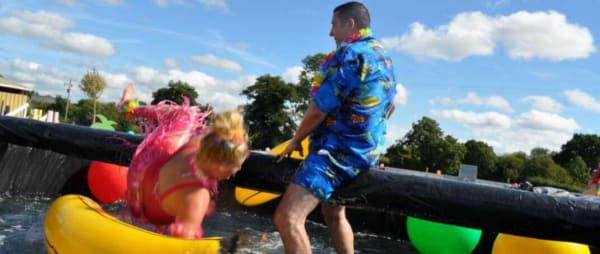 Fundraisers have fun with inflatables on the river