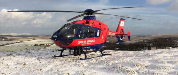Devon Air Ambulance helicopter in the snow