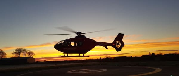 Helicopter at winter sunrise